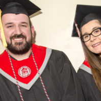 Jacob Turner and Allesondra Straggi posing in graduation robes.