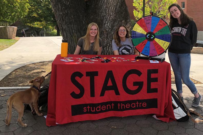 three women students at table near wsu sidewalk