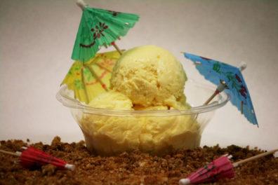A bowl of Tropical Dream ice cream with tiny umbrellas.
