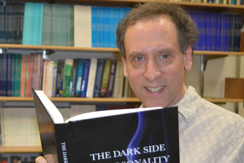 Closeup of David Marcus with book.