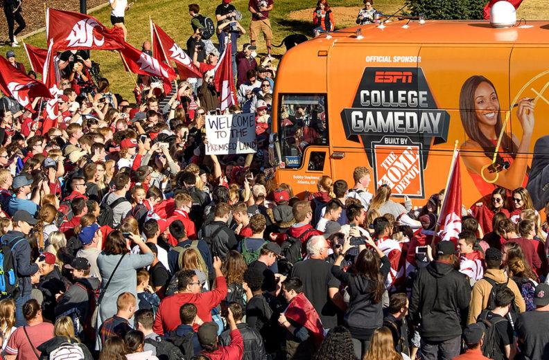 WSU fans swarm street to greet College GameDay bus.