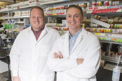 Closeup of Gerstner and Vanderheyden in fruit fly lab at WSU Spokane.