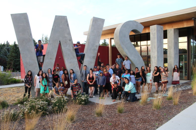 Group photo of Native peoples around the WSU visitor center