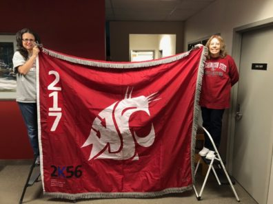 Sharon Macy and Catherine Jasmer hold the Ol' Crimson flag.