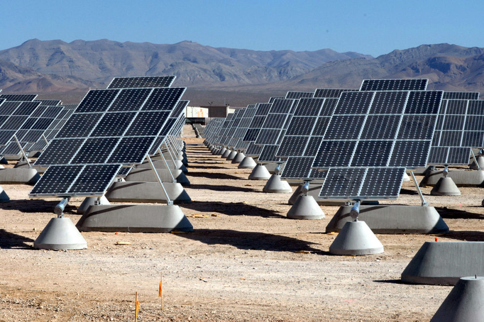 An array of solar panels on a solar farm.