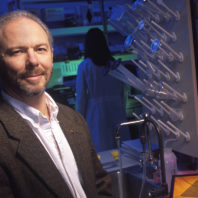 Skinner standing in biological laboratory.