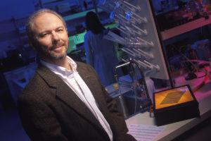 Michael Skinner standing in laboratory.