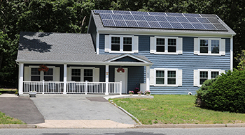 House with solar panels on roof.