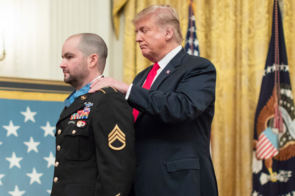 President Donald Trump decorates Shurer with the Medal of Honor.