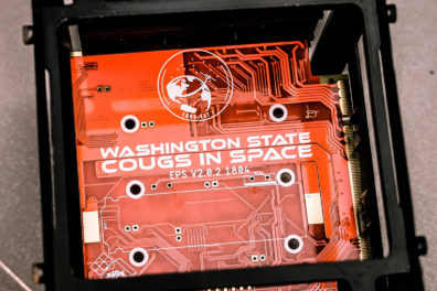 Closeup of electrical circuit board labeled 'Washington State Cougs in Space'.
