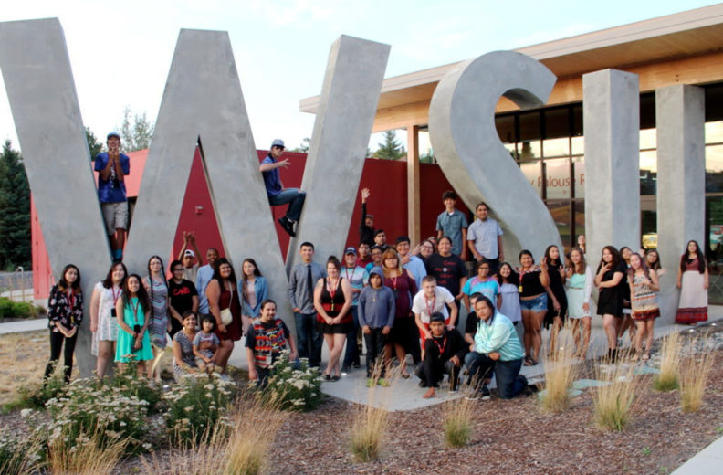 Group of Native peoples outside the WSU Visitor Center.