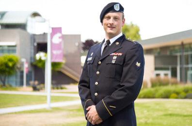 Nolan, in uniform, outdoors on WSU Tri-Cities campus.