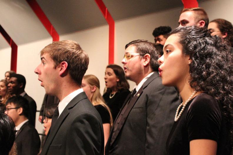Closeup of choir members singing.