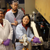 Hang Liu and student researchers in lab demonstrating fabric recycling.