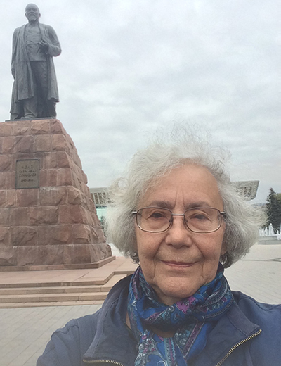 Tolmacheva in front of a statue in Kazakhstan.