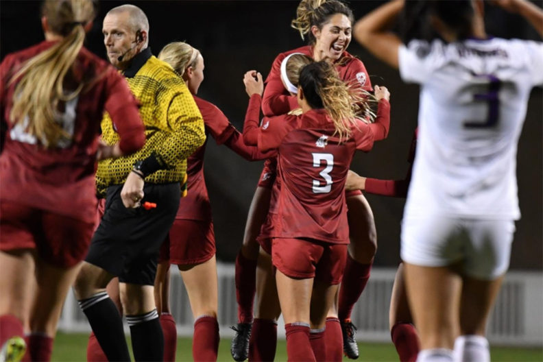 WSU soccer players celebrate after Montana win.