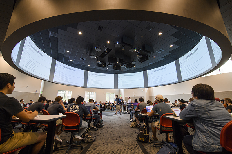 Students sit in circular classroom inside The Spark.