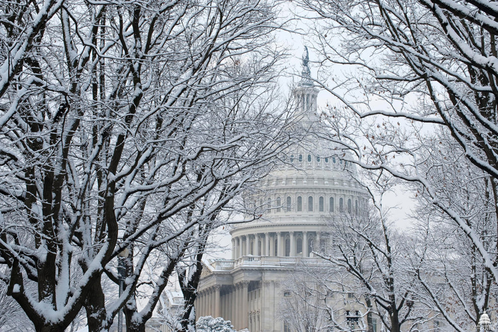 state capitol building with snow cover