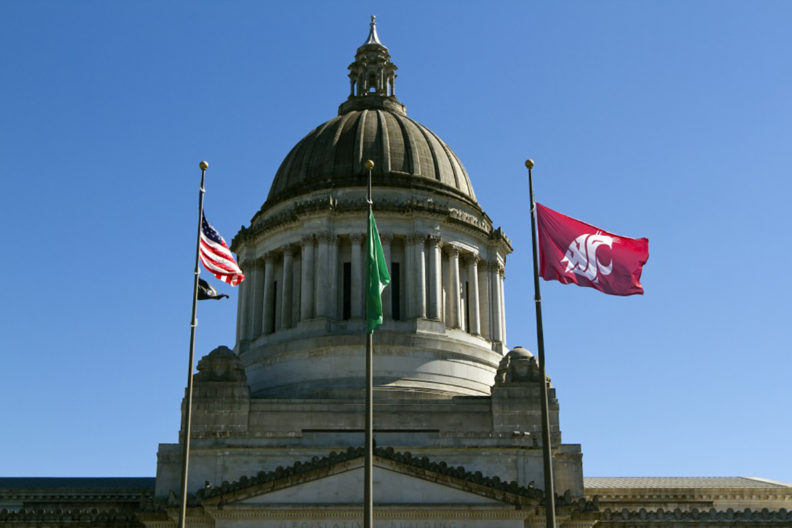 Washington State Capitol building with US, state and WSU flags flying in front.