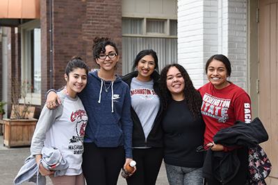 Five female WSU students pose for a group photo outside the Union Gospel Mission.