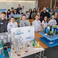 Classroom of middle school students with scale models used in competition.