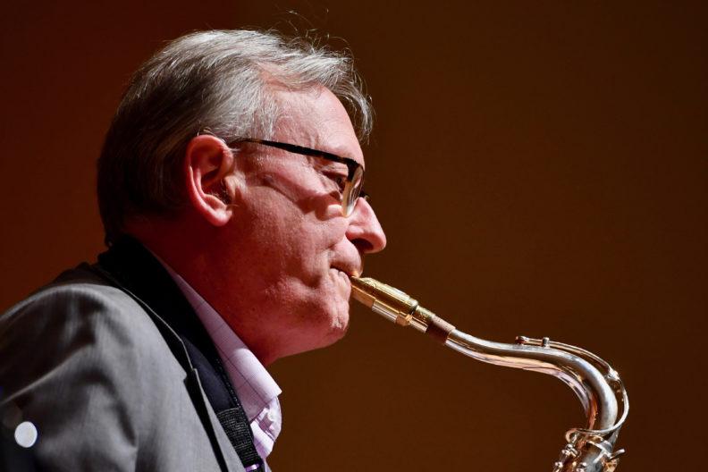 Closeup of Yasinitsky playing saxophone.
