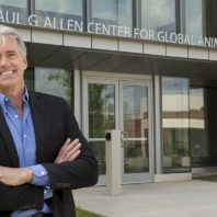 Palmer standing outside the main entrance of the Global Animal Health building.