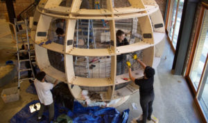 Miyasaka working on a giant sphere.