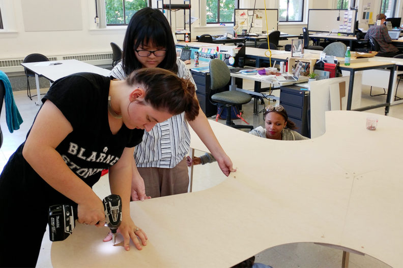 Rosenthal and Kha creating an asterisk-shaped table.