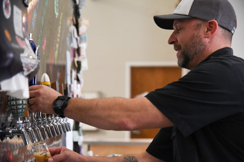 Hopp pouring beer from a tap.