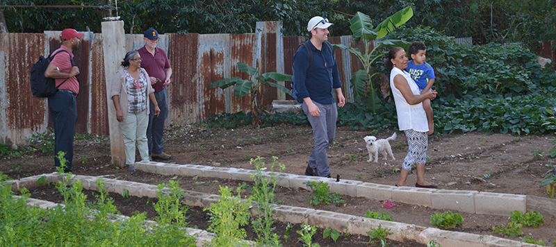 Gromko, Manuela, Pitre and Peterson visit and tour large garden.