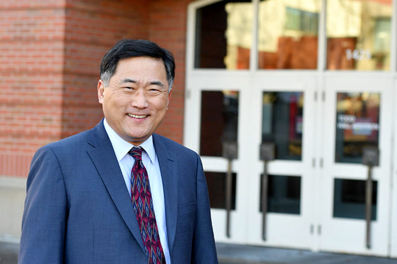Ahn standing in front of Carson College of Business.