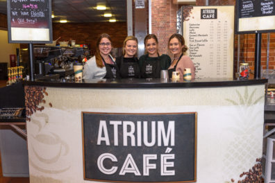 Four Atrium Cafe employees standing in the cafe.
