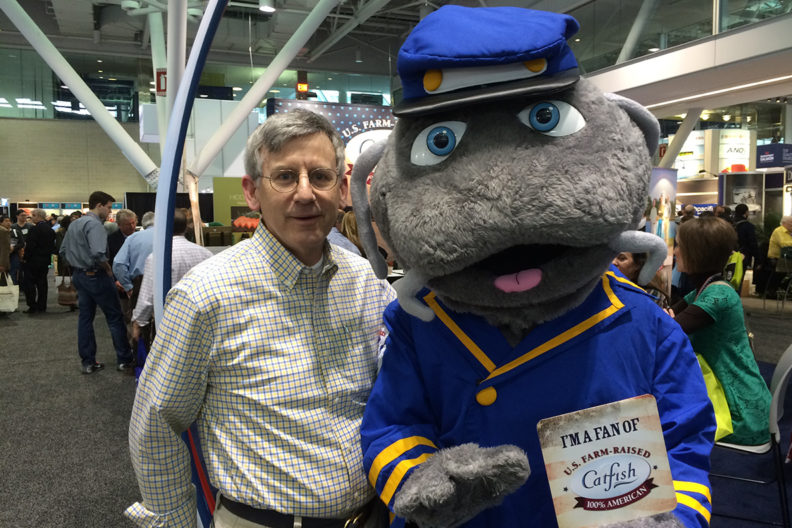 Donegan and a Ivars catfish mascot standing next to him in the Seattle Market