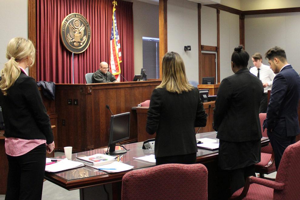 WSU Mock Trial team and Filer presenting mock case in courtroom.