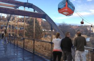 Conceptual art showing gondolas over a footbridge.
