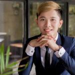 Closeup of Nam Nguyen standing on balcony.