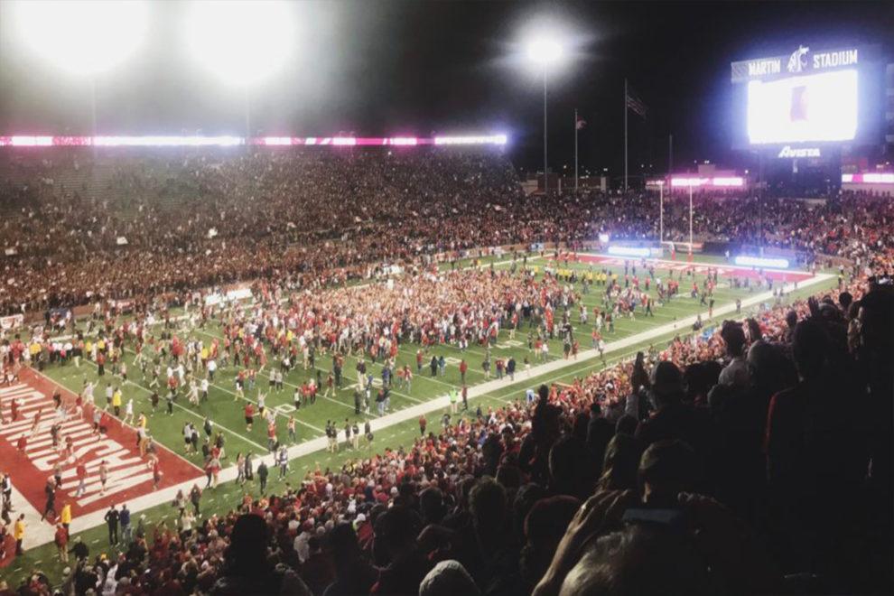 Fans gathering on the field at Martin Stadium