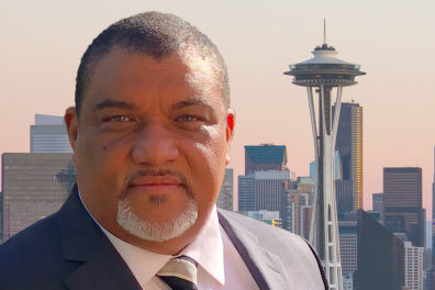 Picture of André-Denis Wright with Seattle in the background.