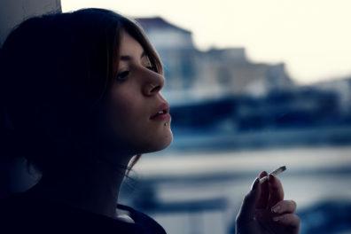 Teenage girl smoking marijuana.