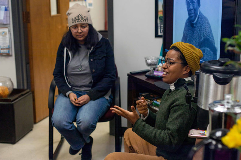 Students conversing in the WSU Women's Center.