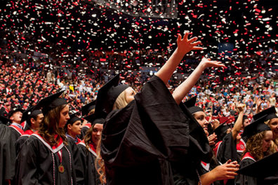 Students celebrating at a commencement ceremony.