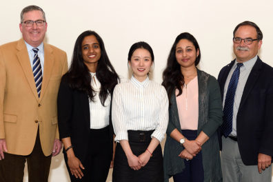 Schulz and Bernardo stand with the winners of the 2019 Three-Minute Thesis competition at WSU.