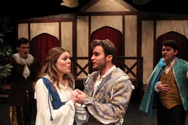 """Actors performing """"The Merry Wives of Windsor"""" on stage."""