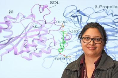 Closeup of Swechha Pokharel in front of scientific diagram.