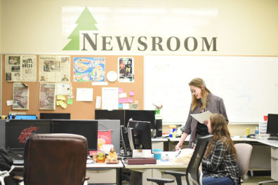 "Students working in ""The Daily Evergreen"" newsroom."