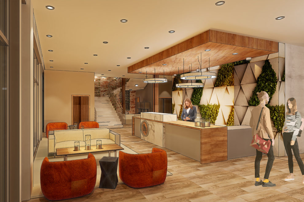 Rendering of a hotel lobby with exposed brick, a green, living wall of plants, and orb lights.