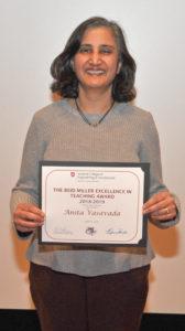 Anita Vasavada holding award.