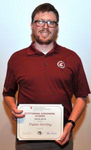 Dylan Sterling holding award.