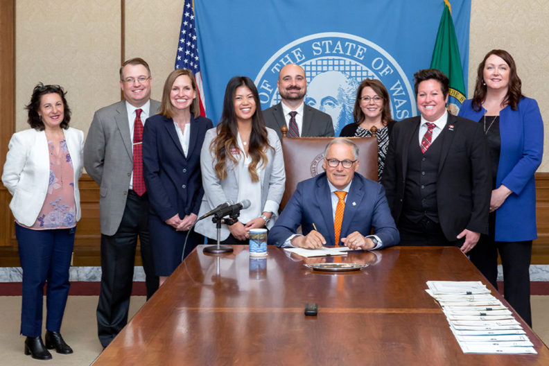 Gov. Jay Inslee signs a bill into law.